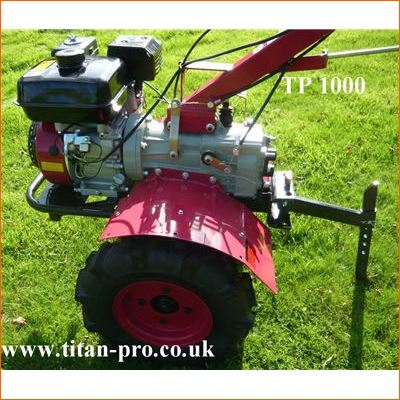 Order a Titan Pro TP1000 Petrol Cultivator, the entry model for our heavy duty range. The TP1000 Garden Cultivator is designed for the small market gardener or large allotment user. Features extra-wide tines ideal for working larger plots. This Tiller now features a 6.5HP OHV engine for improved performance and efficiency, as well as an easy grip clutch lever.